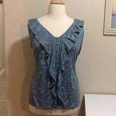 "Lane Bryant teal and grey print top Lane Bryant teal and grey paisley print top. Ruffled front with decorative buttons. Thin stretchy 95% rayon 5% spandex. Measures approx. 26"" long, laying flat 24"" across chest. Women's plus size 22/24 Lane Bryant Tops"