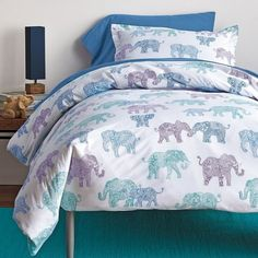 Crisp cotton percale sheets and bedding set with hand-drawn elephants decked out in all their floral finery. Perfect for dorm bedding.