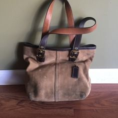 """Coach Tan Suede/brown leather Handbag Authentic Coach Purse. Serial#B33-9579. Tan suede with brown leather trim, bottom, and straps . 9"""" adjustable strap. Full zippered top (needs replacing, but pull zip is included). One inside zippered pocket and 2 open slit pockets. Some dark marks on suede but can be cleaned. Coach Bags"""