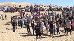 Veterans Day Glamis 2013 flag renewal   The big dunes directly behind China Wall are deep and steep and are also fun to ride. On the way back, we rode by the flagpole, a monument complete with a huge American flag erected as a memorial to local legend Chuck Boardman, the ornery owner of the popular Boardmanville Bar, which is a must-see as well. This spot is also the meeting place for the annual Veterans Day gathering.