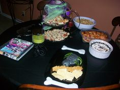 Monster High party food, including spider web 7 layer dip, spider cheese ball, mummy dogs, and mini mummy pizzas