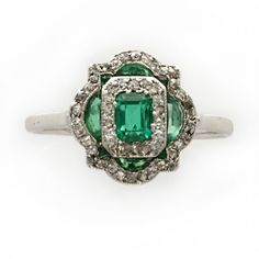 An Art Deco calibré emerald and diamond tablet ring, circa 1920. I Love vintage jewelry.