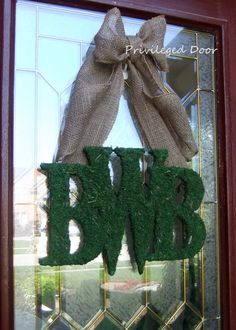 moss initial door wreath