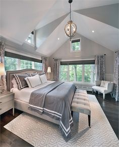 Details such as a double-vaulted ceiling and custom window treatments create unobstructed views in a sophisticated Bethesda master bedroom.