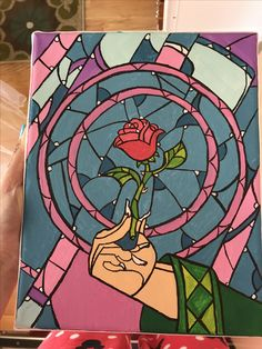 """Stained glass rose from """"Beauty and the Beast"""" painted on canvas using acrylic paints and a ribbon border."""