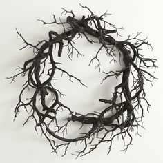 This spooky wreath features ZERO leaves, greenery, flowers, pinecones, bows, berries, or cheer of any kind, just realistically entwined black branches.