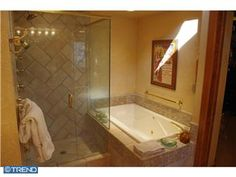 this is so odd, but this photo gives you an idea of what your contractor wanted to do.  Seems an odd layout for getting in and out.  Large tile in shower