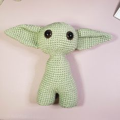 To make the Left ear, fold the top down away from you and insert your hook into the stitch from your hook and make a slip stitch. Finish off and leave a long tail for sewing. Eyebrows Use Frosty Green. Crochet Amigurumi Free Patterns, Crochet Toys, Crochet Baby, Star Wars Crochet, Crochet Skull, Star Wars Baby, Animal Knitting Patterns, Stuffed Animal Patterns, Crochet For Kids