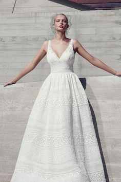 Boho wedding dress idea -  a-line gown features sheer pockets and patterns of eyelet lace, floral motifs, and scalloping. Style Evan from Sottero & Midgley by @maggiesottero.