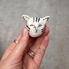 Tiny ceramic cat head. Made by Kaye Blegvad.