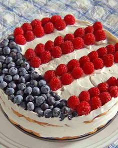 For this Independence Day dessert, layers of vanilla wafers and strawberry whipped cream are topped with fresh berries for a sweet salute to the Fourth of July. 13 Desserts, 4th Of July Desserts, Fourth Of July Food, July 4th, Patriotic Desserts, Summer Desserts, Recettes Martha Stewart, Martha Stewart Recipes, Cupcakes