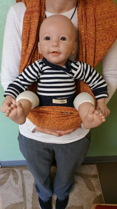 Baby's Bum should be resting in the hammock of the wrap, knees bent, higher than the bum. (Keep in mind this doll doesn't have knees)