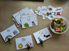 Letter Sound Activity Cards- using mini clothespins to mark the answers, which of the two pictures starts with the letter indicated on the card.