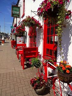 The Arches Restaurant - Adare, County Limerick, Ireland (by Cheryl D.) I LOVE the red and white. (cute use of old bicycle) Dublin, Limerick Ireland, Adare Ireland, Irish Roots, England And Scotland, Emerald Isle, Ireland Travel, British Isles, Northern Ireland