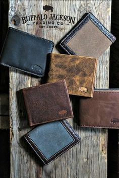 Impressive collection of handcrafted and vintage inspired men's leather wallets…