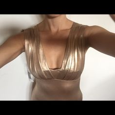 Gold bodysuit NWT!  Never worn and thong bottoms Amazing thong, gold bodysuit bought on Melrose Ave at boutique.  Never ended up wearing it and am currently in closet overhaul season.  Hope it finds a happy home! Tops Tank Tops