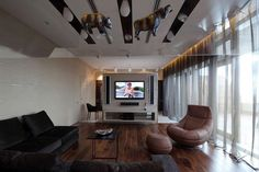 Sophisticated Triplex House: Get Your Home Higher!:Wooden-floor-Black-sectional-sofa-Glass-wall-Cool-drapes