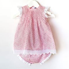 Los Encajeros - Baby dress in Liberty print with handmade pleats to front.