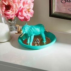 This extraordinary elephant will keep your rings safe and sound. Made with a painted toy elephant and a dish!