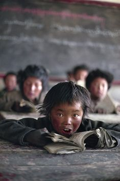 This picture is of a student in Tibet. There are major differences in the school environment pictured here, and the school environment in America. The student and the classroom are dirty, and you do not find those factors in American classrooms.
