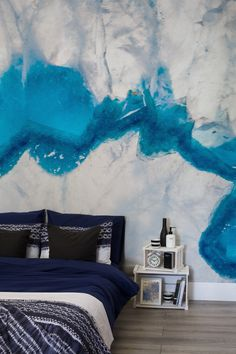 Agate walls are the hottest interior decor must-have this year! This texture wallpaper will create a marbled pattern in your home that will add depth and sophistication. Combine with white furnishings to make the ribbons of blue really stand out.