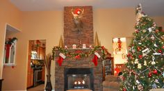 A fireplace gets a facelift for the holidays due to our Regency Stacked Stone faux panels. You can find even more design ideas using these realistic faux stone panels at http://www.fauxpanels.com/portfolio-regency.php