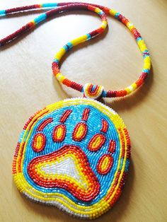 Bear Paw Medallion by on deviantART Indian Beadwork, Native Beadwork, Native American Beadwork, Loom Beading, Beading Patterns, Native Design, Native American Crafts, Nativity Crafts, Feather Painting
