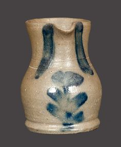 Sold $ 4,250 Very Rare Miniature Stoneware Pitcher with Cobalt Tulip Decoration, attributed to Charles F. Decker's Keystone Pottery, Chucky Valley, TN, late 19th century, finely-potted, thin-walled pitcher with ovoid body, footed base, and tall flaring collar. Midsection embellished with two incised lines. Front decorated with a brushed vertical tulip, and spout flanked by two cobalt stripes. Inverted U-shaped stroke of cobalt above upper handle terminal. Excellen