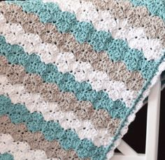 How sweet is this Sea Shell Stitch Crochet Baby Blanket? Crochet shell stitch has never looked so cute! | AllFreeCrochetAfghanPatterns.com
