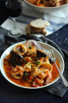 Seafood Stew...simple, quick and delicious stew using canned tomatoes, a little white wine, some saffron and fresh chillies some sautéed fennel along with the onion and add a splash of ouzo...serve with plenty of fresh bread to mop up sauces