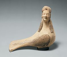 "Terracotta statuette of a siren; ca. 550–500 B.C. ""Sirens are mythical creatures famous in antiquity for their song, which lured sailors to their death. Sanctuaries to the sirens are known to have existed in parts of South Italy and Sicily, as the geographer Strabo and other ancient writers tell us. This large, hand-modeled sculpture with applied decoration may well have been a votive offering at such a sanctuary."""