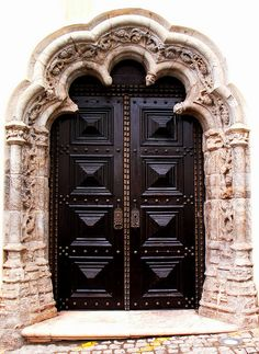 Elvas, Portalegre, Portugal outstanding door gate portal in a stone arch carved wall in metal black and bronze studded details