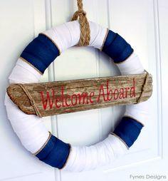 Cute nautical summer welcome aboard wreath: http://www.completely-coastal.com/2015/06/best-summer-wreaths-coastal-beach-nautical.html