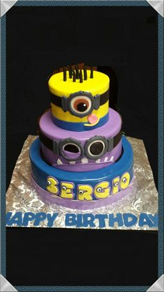 "Yellow Minion and purple evil minion birthday cake. Inspired by simply sweet creations.  12"" pina colada cake with coconut cream filling,  9""strawberry cake with chocolate filling, 6"" chocolate cake with strawberry filling. 2014"