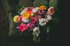 colorful bouquet featuring poppies, ranunculus, tulips, amaranthus and fern by L  S Warehouse