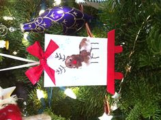 My mom made this cute little easel artwork ornament for our tree with fingerprints and popsicle sticks!