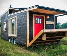 Love the details- porthole window in loft, shower, sliding barn door  Greenmoxie Tiny House