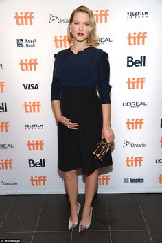 Maternity chic: Lea Seydoux - The 31-year-old kept her outfit simple in a black skirted dress with blue long-sleeved blouse - September 2016