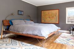 This king bed fits just fine in the spacious master. Rugs are from World Market. The vintage map was found on Craigslist.