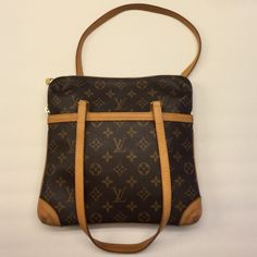 Louis Vuitton Coussin GMmonogrammed canvas handbag Authentic , LV monogrammed Coussin GM pretty , 10.5x10.5 , felt material inside , clean , no rips or stains , top of handles are honey patina , just beautiful, wear on shoulder too, felt inside in big and small compartment are intact , usable , corners have some markings from normal use ,  date code is SD0074 SEE XTRA pictures in another listing, No TRADES Louis Vuitton Bags