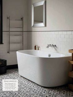 Bath shape is practical, tiling on floor and walls is nice