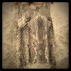 Plus Size - INC snake print sleeveless top Not the best backdrop for this one, I know! Very soft fabric with a sheer panel at the top; gray snake print. Will be amazing under a black blazer! Dress it down with jeans or up with slacks. INC International Concepts Tops Blouses