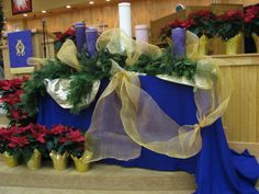 This Advent wreath was in the newsletter from the Fellowship of United Methodists in Music and Worship Arts. I love the handmade pillar candles--the size of the display is so much larger than the advent wreaths that are usually displayed. The large candles and greenery display create an image of majesty and generosity. No scrimping in God's gift of self to humanity!
