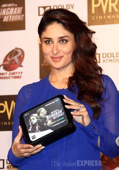 Kareena Kapoor holds up a Singham Returns lunchbox for a closer look at the launch of the movies merchandise. #Style #Bollywood #Fashion #Beauty