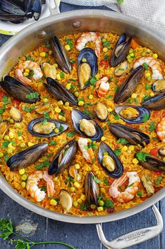 An easy version of the classic Spanish dish Seafood PaellaSeafood Paella! An easy version of the classic Spanish dish that is easy enough to prepare for a weeknight dinner, but delicious enough to serve to company. Fish Recipes, Seafood Recipes, Gourmet Recipes, Mexican Food Recipes, Cooking Recipes, Healthy Recipes, Ethnic Recipes, Seafood Paella Recipe, Clam Recipes