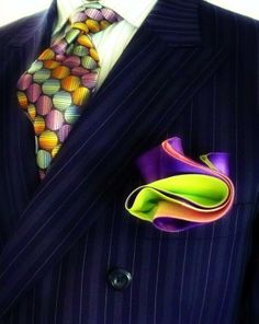 "Don't you love it?! Color ""pop.""  I love the fold of that pocket square. Rdee"