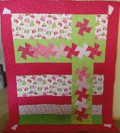 "I made this for my granddaughter and her ""big"" girl bed.  Pattern is ""With a Twist"" by bean counter Quilts.  Most of fabric is from The Noble Quilter (and some from Hawaii)."