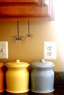 spiders hanging out around the house... love this fun, easy Halloween project... vinyl spiders using Silhouette @Erin Parsoneault Lincoln