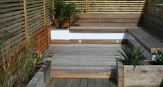 Decking and oak sleeper flowerbeds    By London garden designers - Joseph Lauder Design