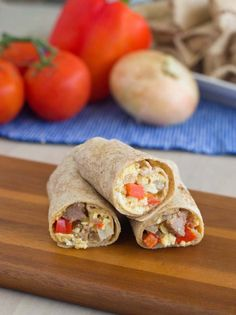 Make-Ahead Freezable Breakfast Burritos - Mornings are a busy time for parents. It can be difficult to make a protein-packed breakfast and get out the door. These breakfast burritos can be made ahead of time and frozen for easy reheating and eating. @produceforkids